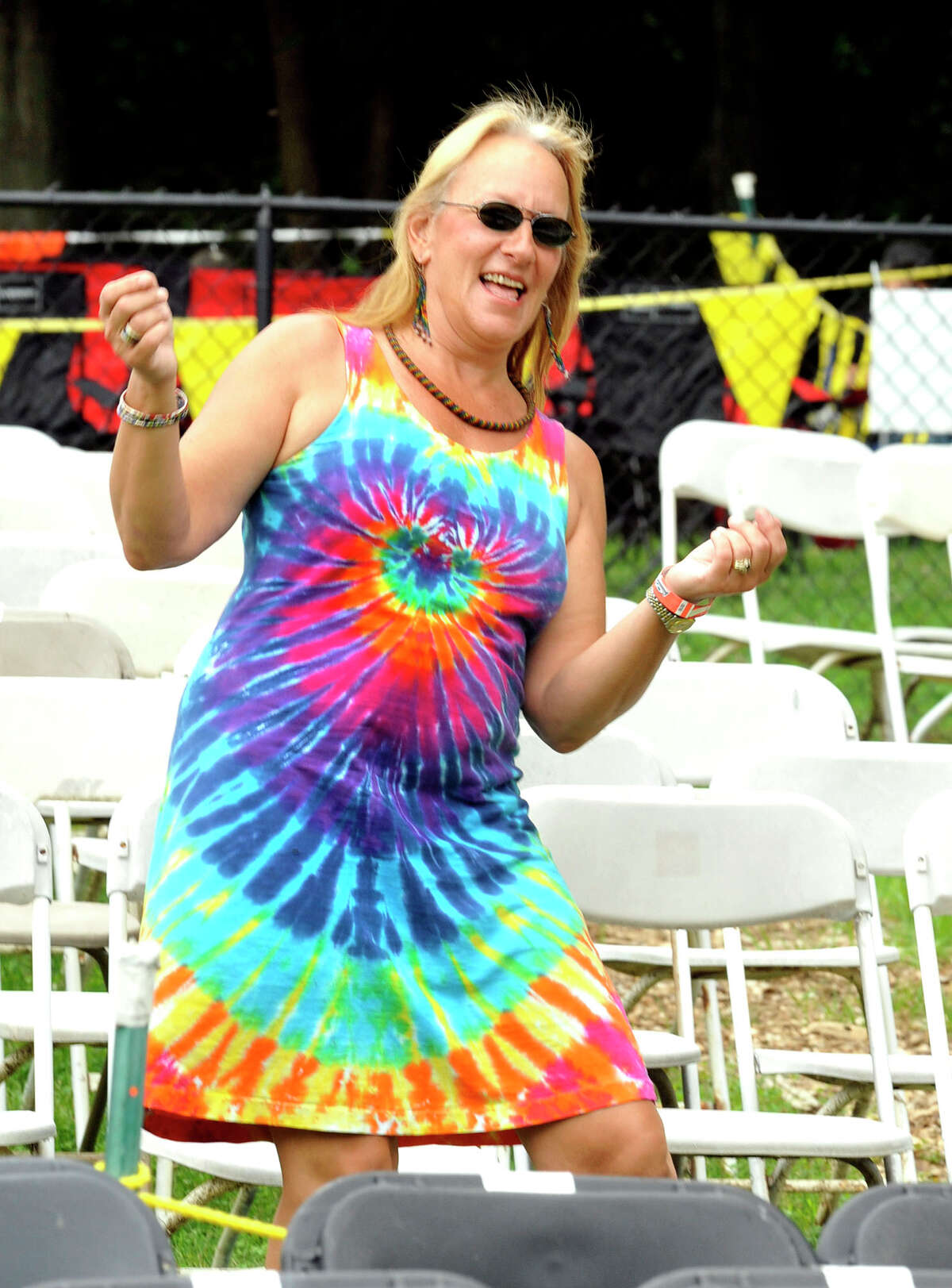 """A free spirit gets her groove on at The Beatles music festival """"Danbury Fields Forever"""" at Ives Concert Park back in 2012. This year's festival will run for two days, Saturday and Sunday, July 26 and 27. There will be 20 bands, plus food, kids' activities and many other attractions."""