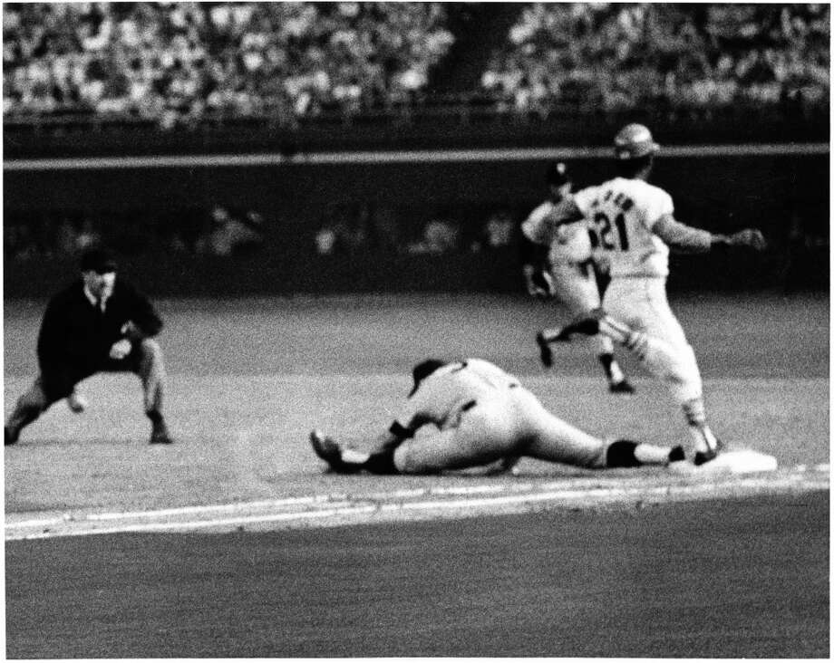 Twins first baseman Harmon Killebrew pulls his hamstring in his right leg after stretching for the ball to put Curt Flood out in the third inning of the 1968 Major League Baseball All Star Game. Photo: George Honeycutt, © Houston Chronicle