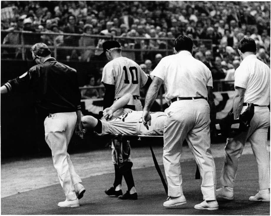 Twins first baseman Harmon Killebrew is carried out with a pulled hamstring in the third inning of the 1968 Major League Baseball All-Star Game. Photo: George Honeycutt, © Houston Chronicle