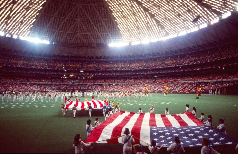 Flags unfurled at the 1986 All-Star Game opening ceremony in the Astrodome. Photo: Carlos Rosales, Houston Chronicle
