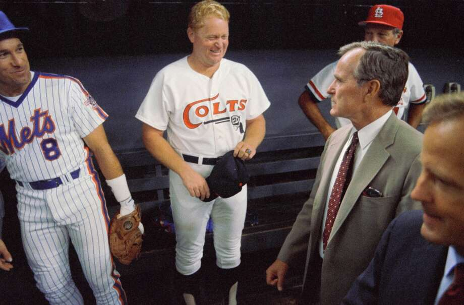 In the dugout before the 1986 All Star game in the Astrodome are, left to right, Gary Carter, Rusty Staub and Vice President George H.W. Bush. Photo: Howard Castleberry, © Houston Chronicle