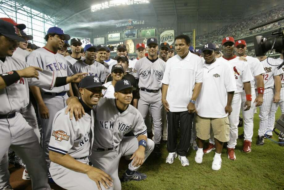 American boxing legend Muhammad Ali poses for a photo with the players during the 2004 All-Star Game  at Minute Maid Park. Photo: Rich Pilling, MLB Photos Via Getty Images