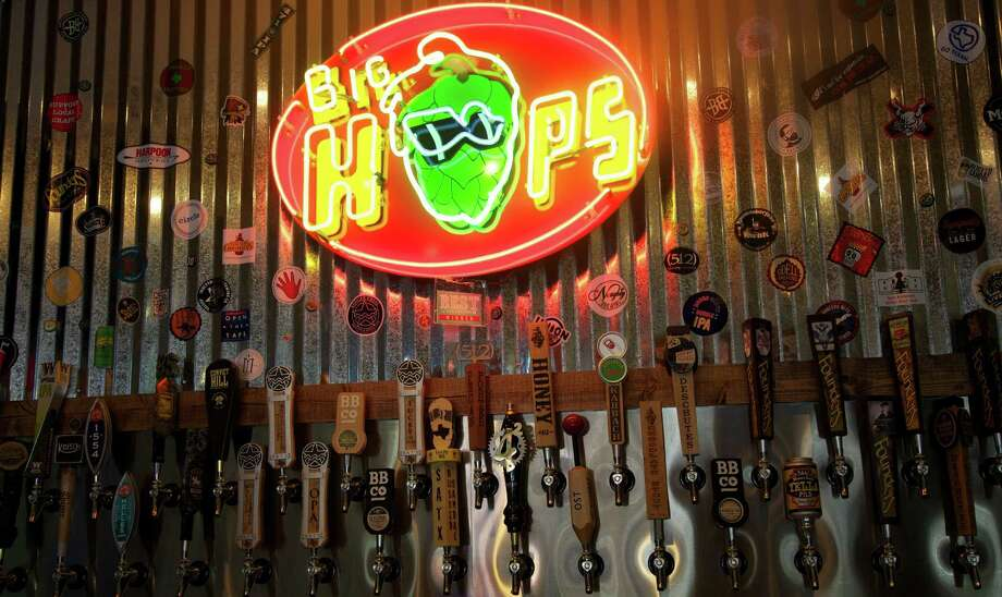 Brew lovers can choose from 51 beers on tap at Big Hops Gastropub. Photo: Xelina Flores-Chasnoff / For The Express-News / For the Express News