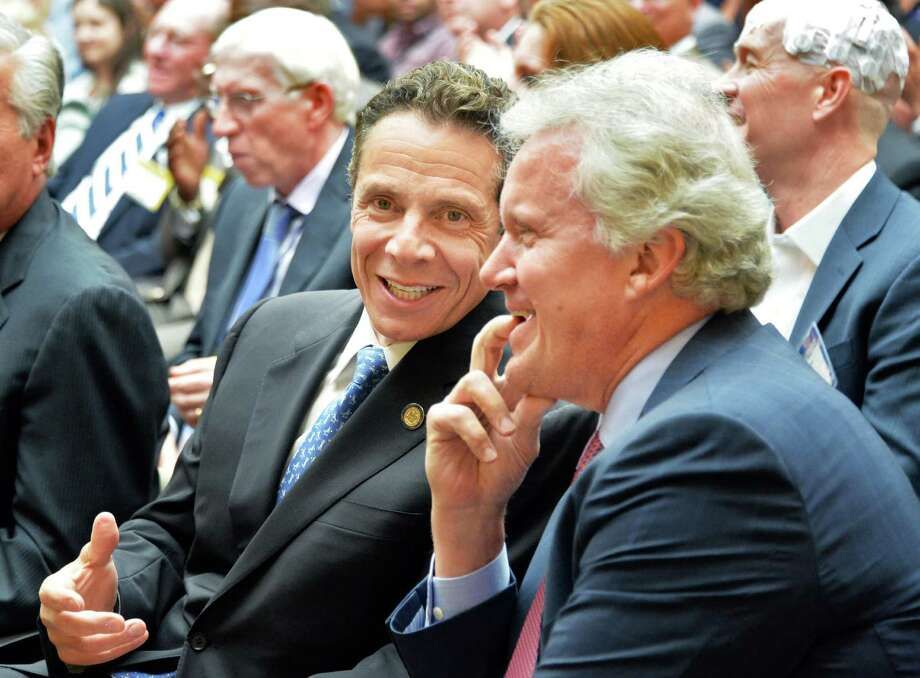 Gov. Andrew Cuomo and GE CEO Jeff Immelt, right, talk during the announcement of a new $500 million power electronics manufacturing consortium in the Capital Region at GE Global Research Tuesday, July 15, 2014, in Niskayuna, N.Y.  (John Carl D'Annibale / Times Union) Photo: John Carl D'Annibale / 00027804A