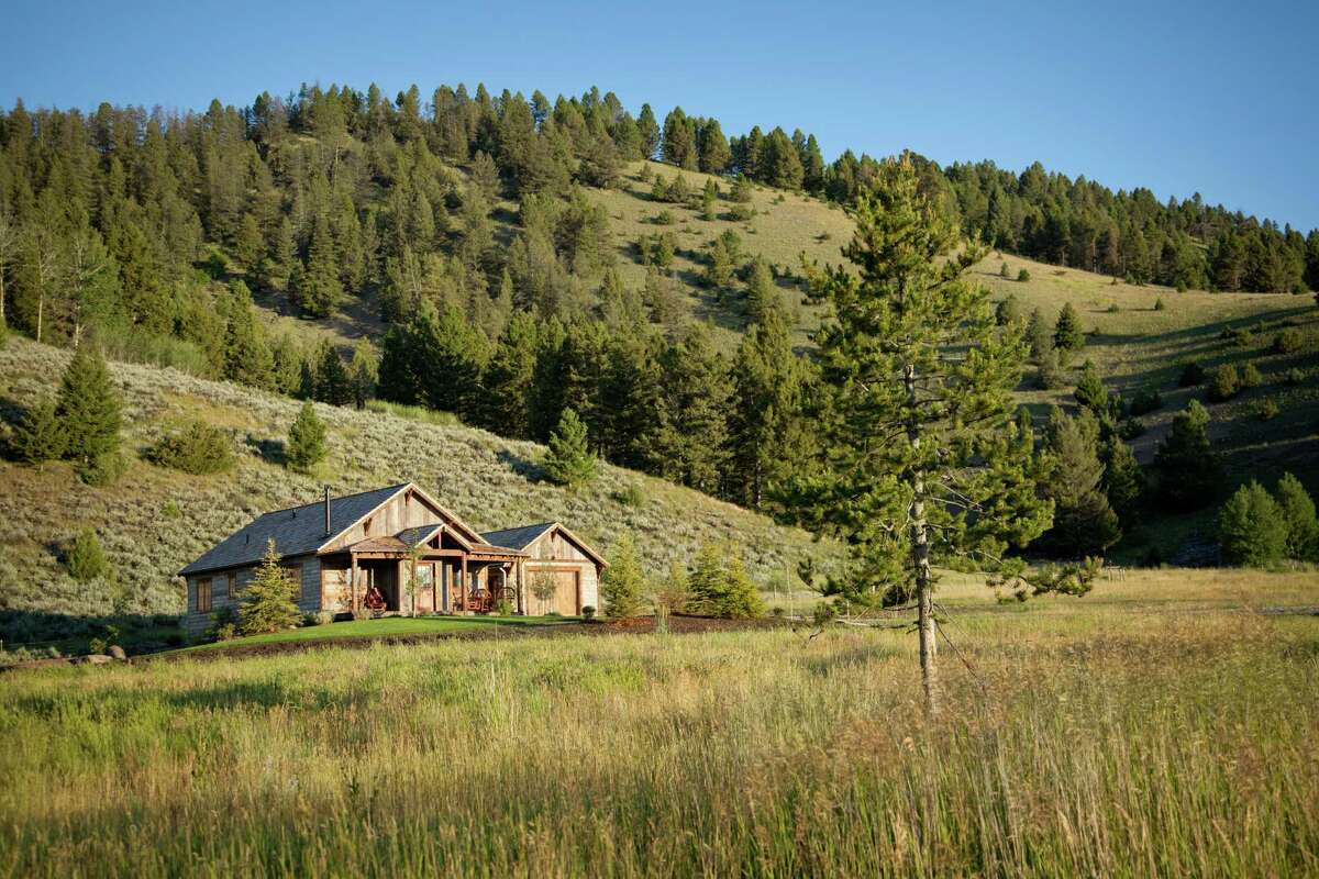 """19. The Ranch at Rock Creek, Montana. Rate: $2,385 a night. Live the dude-ranch life, but with 5-star amenities. This luxury ranch is on 6,000 acres, where guests can ride horses, fly-fish and stay in """"Sarah Jane's Cottage,"""" pictured."""