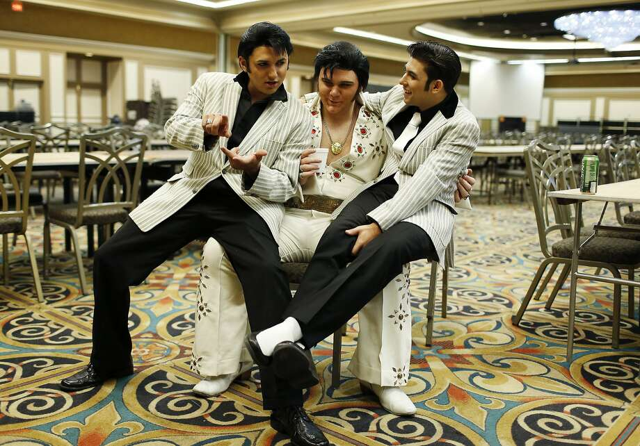 The men who would be King:Daniel Jenkins (left), Tyler James and Jacob Roman joke around after an   Elvis tribute competition during the Las Vegas Elvis Festival. Photo: John Locher, Associated Press