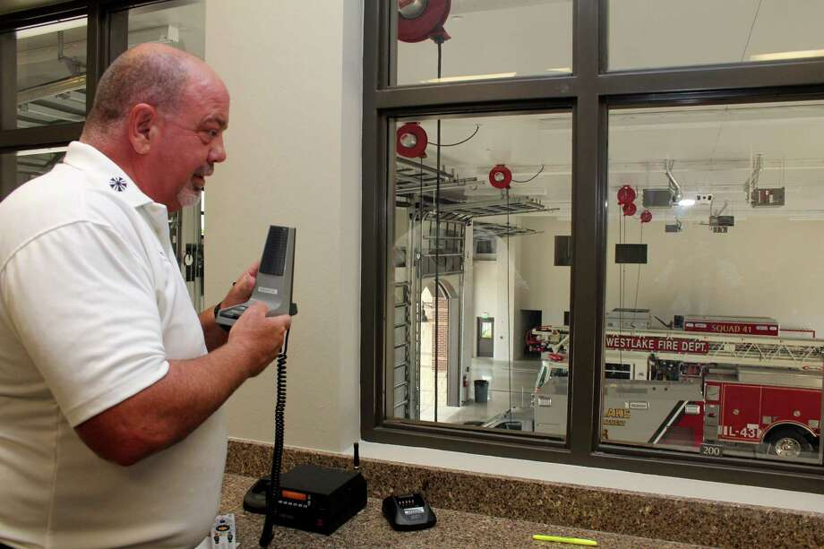 Fire Chief Mark Palmer uses his radio inside the watch office over looking the station garage of the new Westlake Fire Station at 19636 Saums Road. Fire Chief Mark Palmer uses his radio inside the watch office over looking the station garage of the new Westlake Fire Station at 19636 Saums Road. Photo: Suzanne Rehak, Freelance Photographer