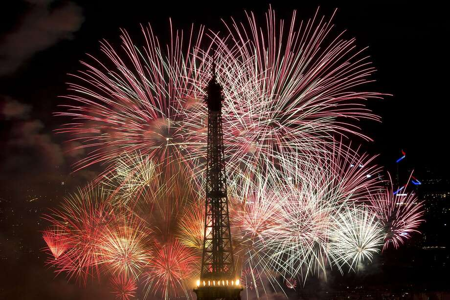 Vive la revolution! Fireworks burst around the Eiffel Tower on Bastille Day in Paris. Photo: Kenzo Tribouillard, AFP/Getty Images