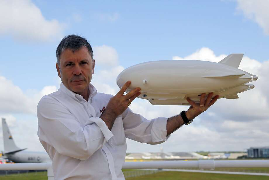 Iron Maiden frontman a zeppelin fan: Bruce Dickinson, lead singer of the metal band Iron Maiden and founder of Cardiff Aviation Ltd., poses with a model Airlander hybrid air vehicle at the Farnborough International Airshow in Farnborough, U.K. Dickinson is a major investor in the airship. Photo: Paul Thomas, Bloomberg