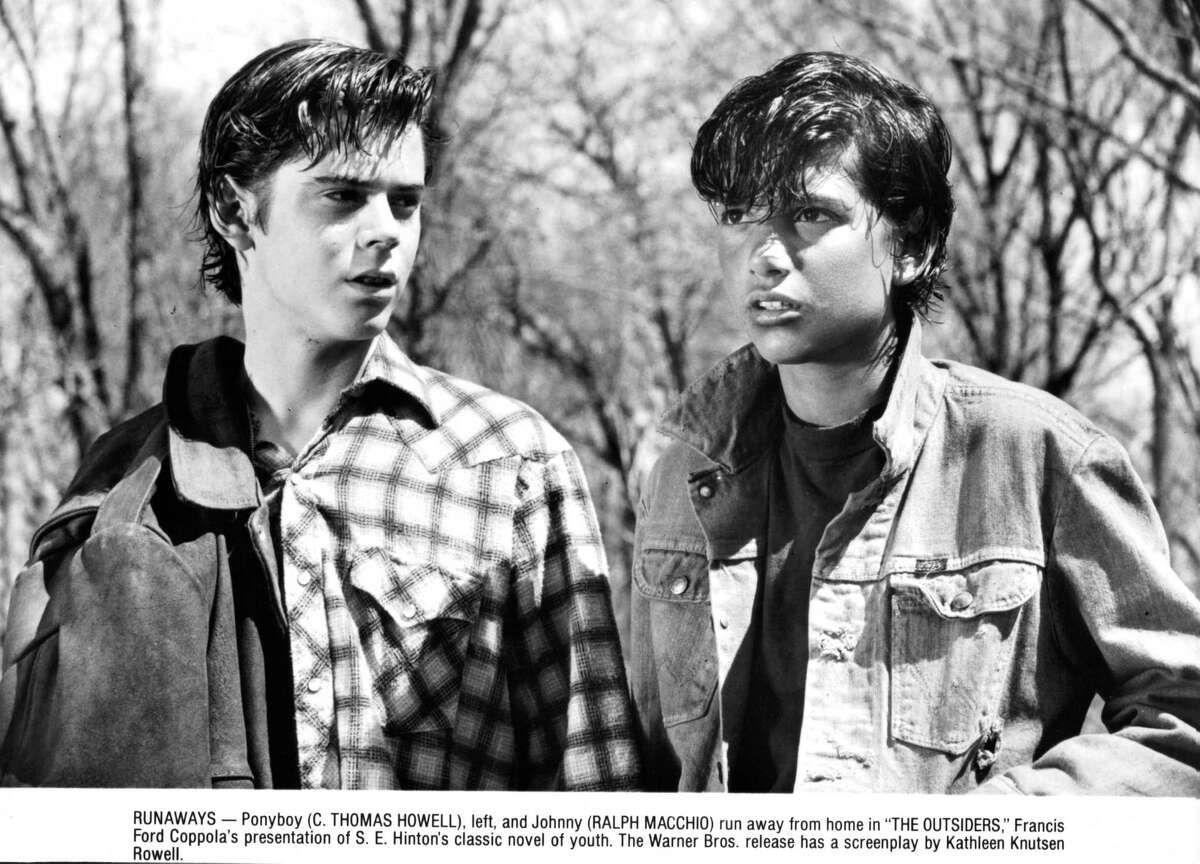 """Macchio played Johnny Cade in 1983's """"The Outsiders"""" alongside several others who would soon become megastars, such as C. Thomas Howell (pictured, left), Tom Cruise, Emilio Estevez, Patrick Swayze, Rob Lowe and Matt Dillon.When he played young, awkward teen Daniel LaRusso in """"The Karate Kid,"""" Macchio was 22 years old. Even as a young lad he did not age.Of course, he went on to star in """"The Karate Kid""""'s two sequels, which premiered in 1986 and 1989."""