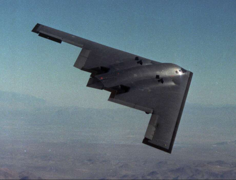 The first B-2 stealth bomber soars over the Mojave Desert during its maiden flight, on July 17, in 1989. Photo: Associated Press / NORTHROP CORP.