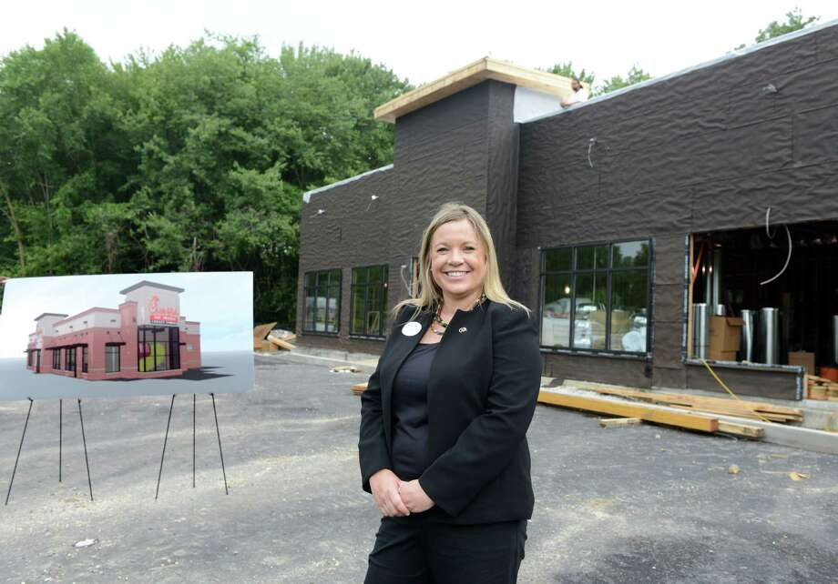Owner Devon Scanlon, of Brookfield, stands in front of what will be Connecticut's first Chick-fil-A Tuesday, July 15, 2014 in Brookfield, Conn. The store is opening this fall. Photo: Autumn Driscoll / Connecticut Post