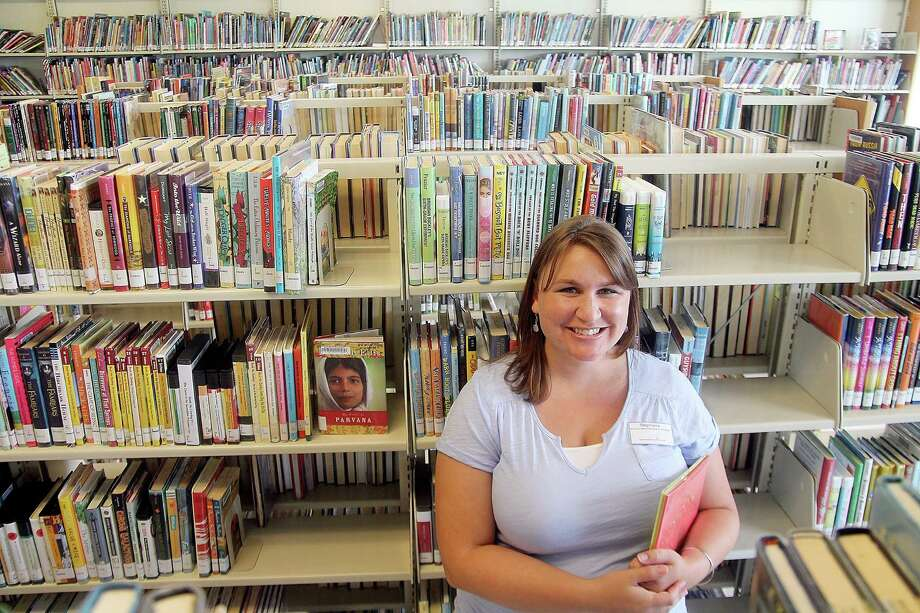 Stephanie Carter, manager at the Pearland Westside Library, stands in front of the wall where the expansion will be. Stephanie Carter, manager at the Pearland Westside Library, stands in front of the wall where the expansion will be. Photo: Pin Lim, Freelance / Copyright Pin Lim.