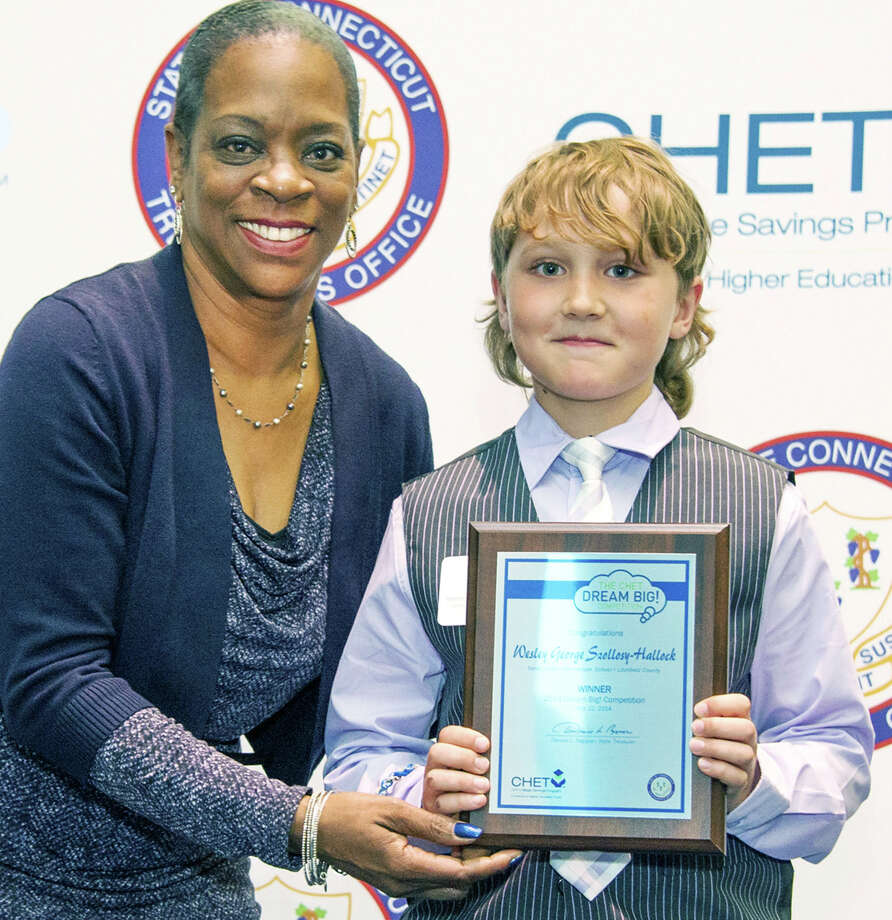 """New Milford elementary school student Wesley George Szollosy Hallock was among this yearâÄôs 63 statewide """"Dream Big!"""" competition winners. Here Wesley is feted by state treasurer Denise L. Nappier. Photo: Contributed Photo / The News-Times Contributed"""
