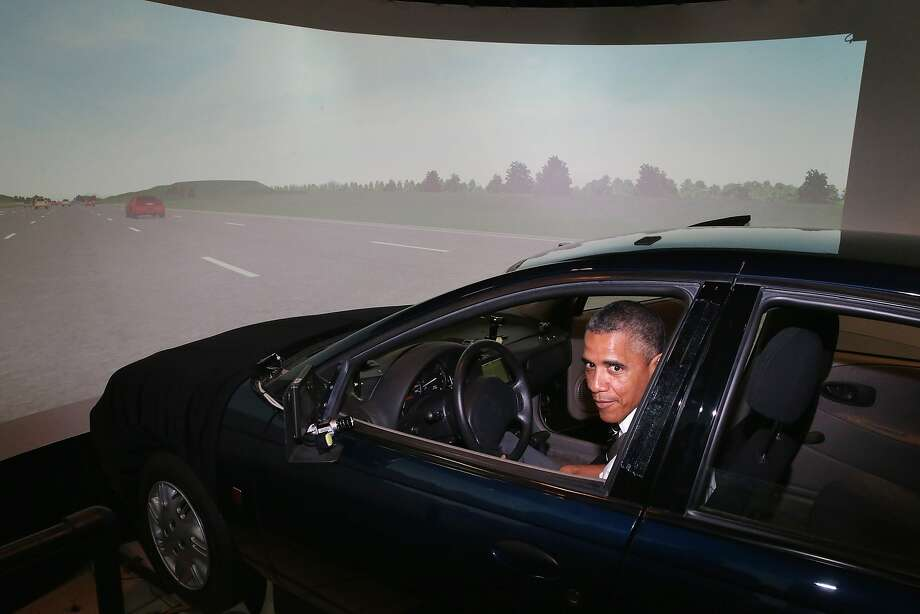 President Obama sits behind the wheel of a driving simulator while touring the Federal Highway Administration's Turner-Fairbank Highway Research Center in McLean, Va. Photo: Chip Somodevilla, Getty Images