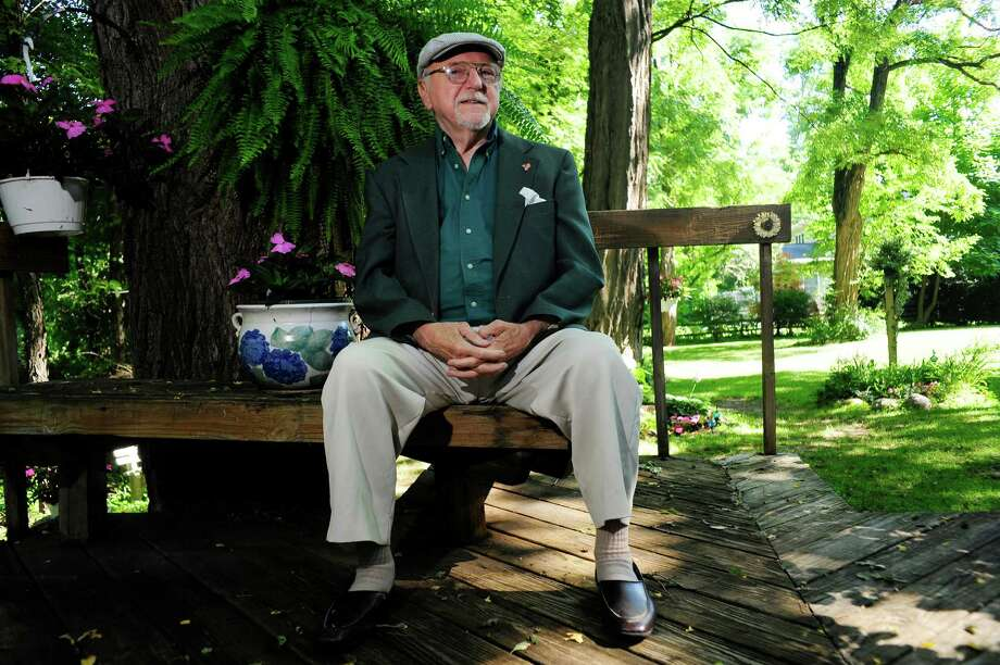 Frank Demetrowitz sits on his backyard porch  on Thursday, July 10, 2014, in Clifton Park, N.Y.  Demetrowitz is in the process of preparing for long-term care for himself and his wife.  (Paul Buckowski / Times Union) Photo: Paul Buckowski / 00027712A