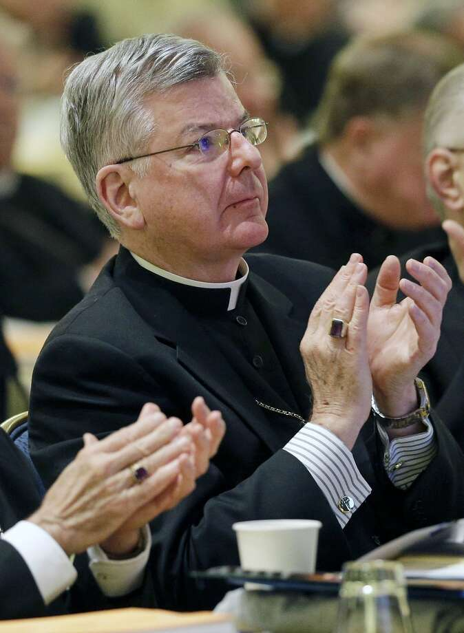 FILE - In this Nov. 12, 2013 file photo, Archbishop John Nienstedt, of St. Paul and Minneapolis, applauds after a presentation at the United States Conference of Catholic Bishops' annual fall meeting in Baltimore. Jennifer Haselberger, the whistleblower who took on the Archdiocese of St. Paul and Minneapolis about allegations of clergy sexual misconduct, said in an affidavit released Tuesday, July 15, 2014, that archbishops and staff ignored the 2002 pledge by Roman Catholic bishops to keep abusive clergy out of parishes.  (AP Photo/Patrick Semansky, File) Photo: Patrick Semansky, Associated Press