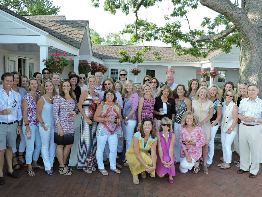The real estate agents at Kelly Associates in Darien were treated to an evening of fun and relaxation at a party June 30 at the Wee Burn Beach Club in the Rowayton section of Norwalk. Photo: Contributed Photo, Contributed / Darien News