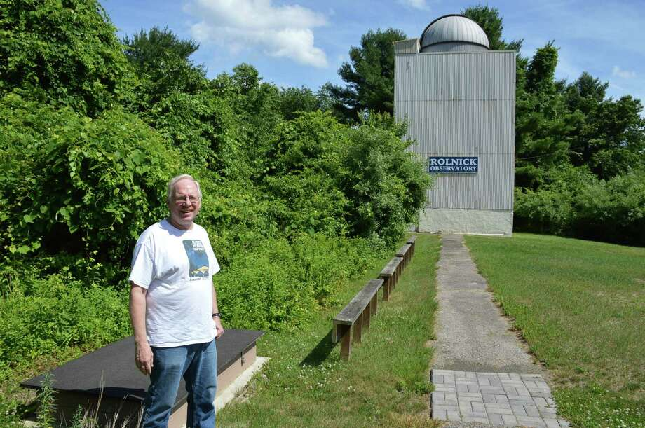 Bob Meadows, vice president of the Westport Astronomical Society, stands in front of the ground vault that holds instruments that measure seismic activity. Photo: Jarret Liotta / Westport News