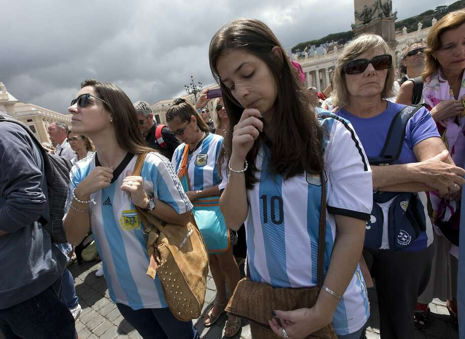 Argentina fans pray in St. Peter's square in the Vatican on Sunday, where even the pope tweeted about the World Cup. Photo: Alessandra Tarantino, Associated Press
