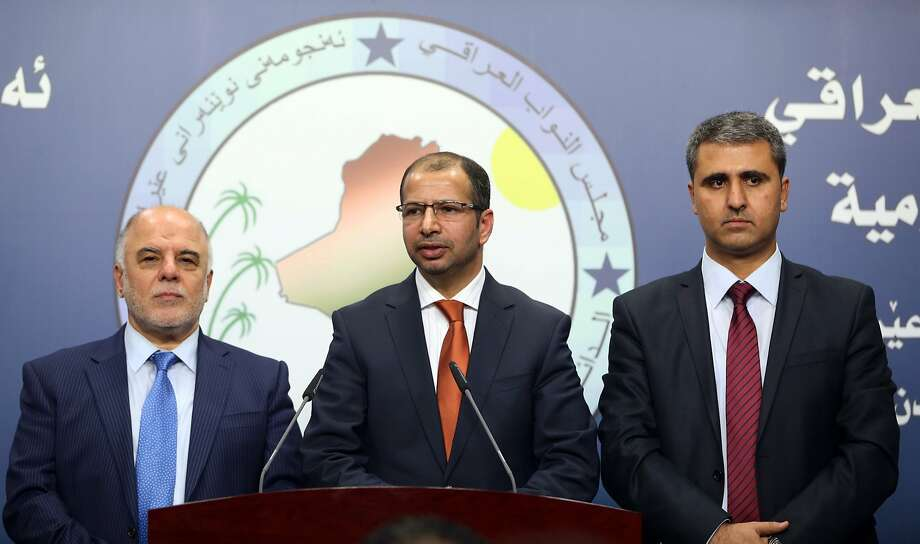 Iraqi new Parliament Speaker Salim al-Jubouri, center, and his deputies, Shiite lawmaker Haider al-Ibadi, left, and Kurdish lawmaker Aram Sheik Mohammed, right, speak to the media after an Iraqi parliament session in Baghdad, Tuesday, July 15, 2014. Iraqi lawmakers broke two weeks of deadlock Tuesday and elected a new speaker of parliament, taking the first step toward forming a new government that is widely seen as crucial to confronting militants who have overrun much of the country. (AP Photo/Hadi Mizban) Photo: Hadi Mizban, Associated Press