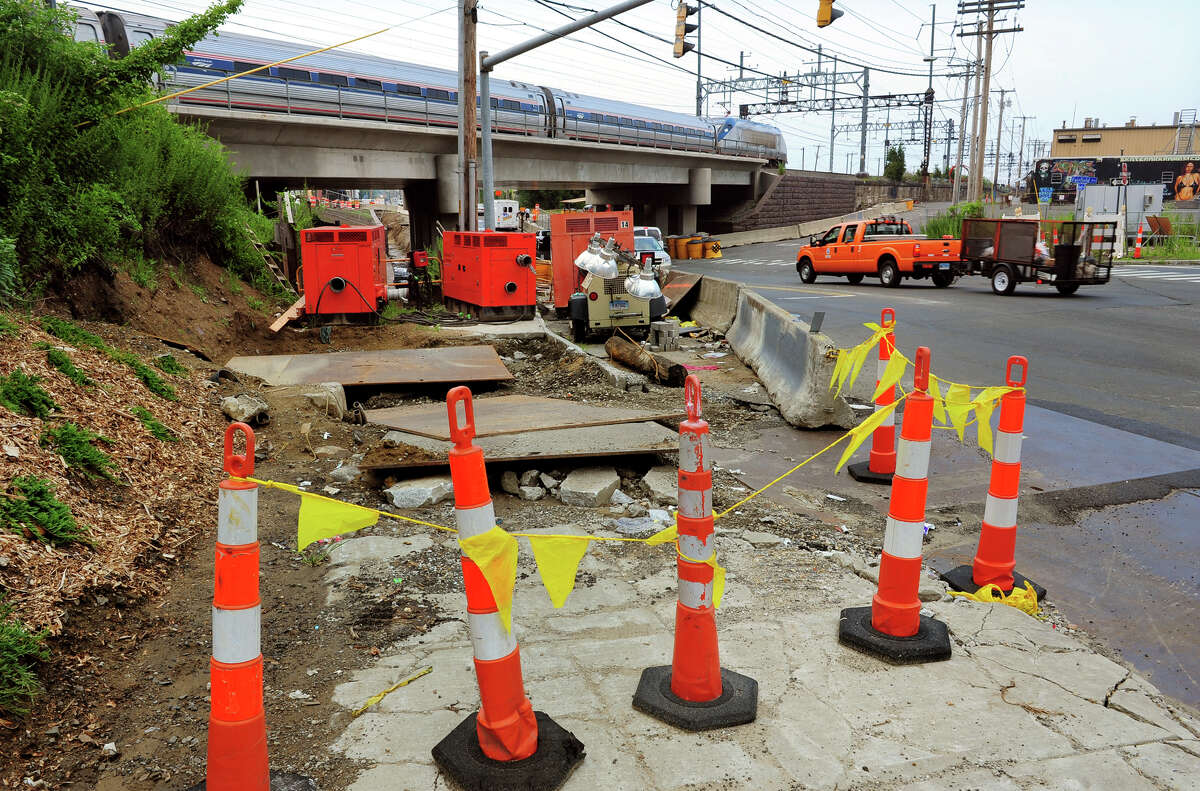 Barriers block the sidewalk at the railroad overpass along Fairfield Avenue in Bridgeport, Conn. on Tuesday July 15, 2014.