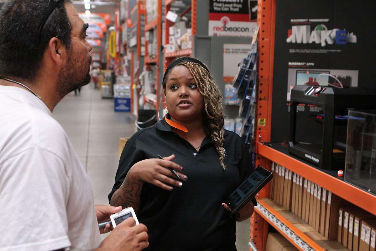 Ivan Rodriguez of El Cerrito, left, talks with Esha Horton, a retail operator for MakerBot 3-D printers, at the Home Depot in Emeryville, Calif. on Monday, July 14, 2014. Certain branches of the home improvement chain will carry MakerBot 3-D printers nationwide, including stores in Emeryville, East Palo Alto and San Carlos.