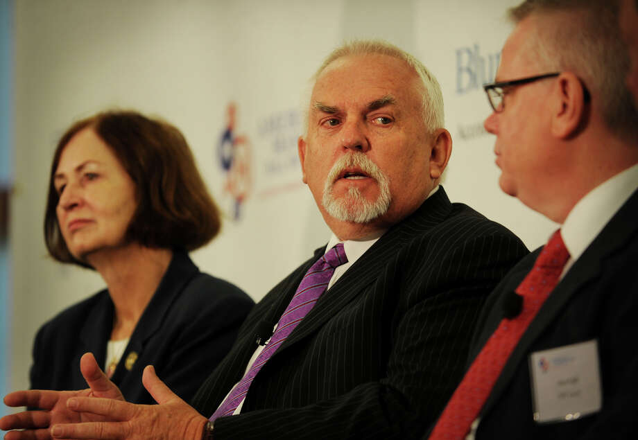From left; Housatonic Community College President Anita Gliniecki, actor and Bridgeport native John Ratzenberger, and PEP Lacey President Ken Lisk at the announcement of the American Manufacturing Hall of Fame at Housatonic Community College in Bridgeport, Conn. on Tuesday, July 15, 2014. Ratzenberger, a manufacturing advocate, is serving as the museum's inaugural chair. Photo: Brian A. Pounds / Connecticut Post