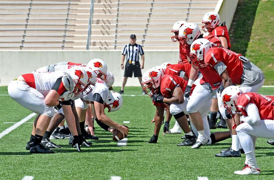 Lamar offense and defense line up during the Lamar University football scrimmage at Provost-Umphrey Stadium on Saturday, April 13, 2013. Photo taken: Randy Edwards/The Enterprise