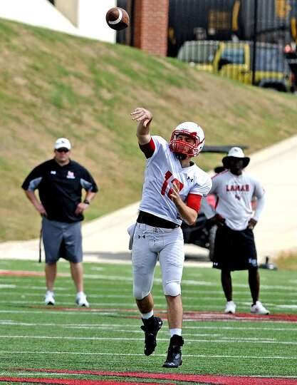 Quarterback Caleb Berry, #12, throws down the field during the Lamar University football scrimmage o