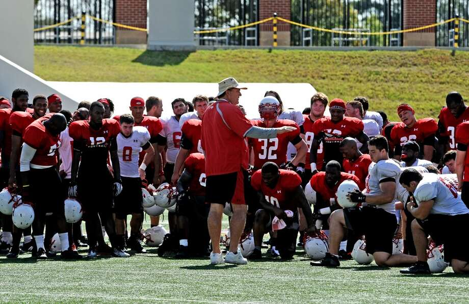 Coach Ray Woodard speaks to the team after the Lamar University football scrimmage on Saturday, August 24, 2013. Photo taken: Randy Edwards/The Enterprise Photo: Beaumont Enterprise