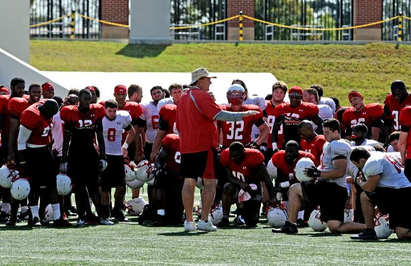 Coach Ray Woodard speaks to the team after the Lamar University football scrimmage on Saturday, Augu