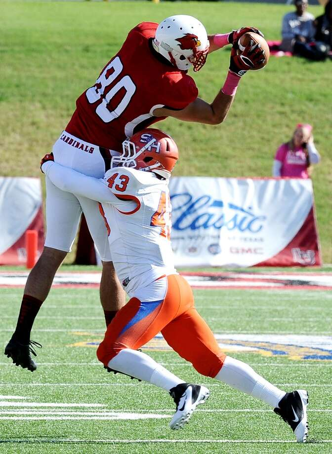 Lamar tight end Cory Soto makes a great catch for another Cardinal first down during the football game between Lamar University and Sam Houston State University at Provost Umphrey Stadium on Saturday, October 27, 2012. Photo taken: Randy Edwards/The Enterprise