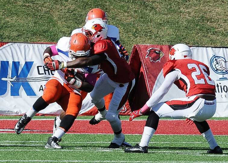 SHSU running back Timothy Flanders is stopped by a group of Lamar defensive players before getting a