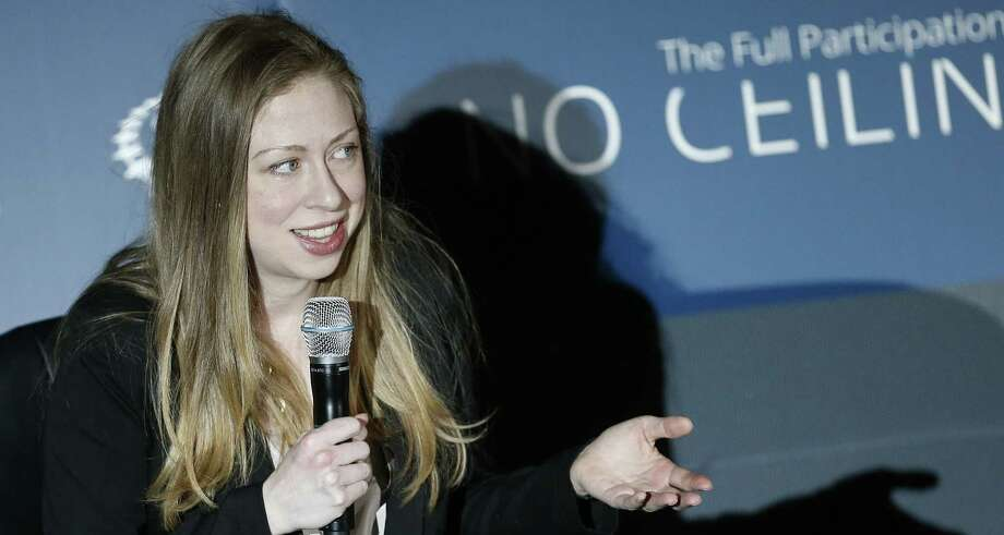 "Clinton Foundation Vice Chair Chelsea Clinton speaks while hosting an event titled ""From STEM to Success: A No Ceilings Conversation,"" at the Colorado Museum of Nature and Science last month. She has joined the family business, raking in speaking fees. Photo: Brennan Linsley / Associated Press / AP"