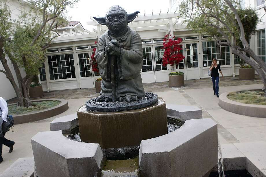 "Yoda fountain at the Presidio. The life-size, bronze Jedi master stands guard at the Lucasfilm HQ. If you make the visit on a weekday during business hours, you'll be able to go to the Lucasfilm lobby where there is incredible ""Star Wars"" memorabilia including a life-size Darth Vader and Boba Fett. While there isn't much to do besides take pictures, you can enjoy a stroll across the beautiful park and look for the statues of the ""Father of Television"" and the ""Father of Film."" The statue is located at The Presidio, 1 Letterman Dr., S.F. Photo: Liz Hafalia, The Chronicle"