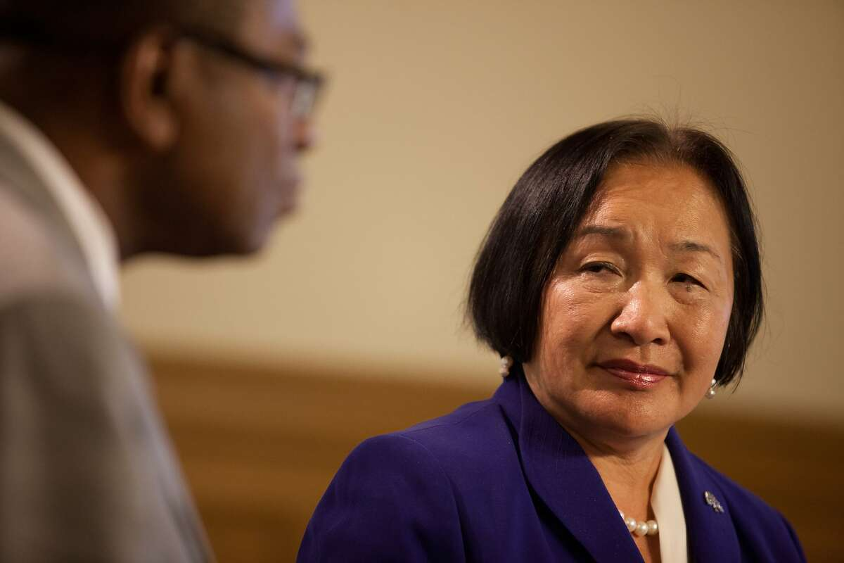 Oakland Mayor Jean Quan, right, and City Administrator Henry Gardner, left, speak about keeping the A's and Raiders in Oakland and signing the lease agreement to move forward with discussions about building a new stadium for the A's at Oakland City Hall in Oakland, Calif. on Wednesday, July 9, 2014.