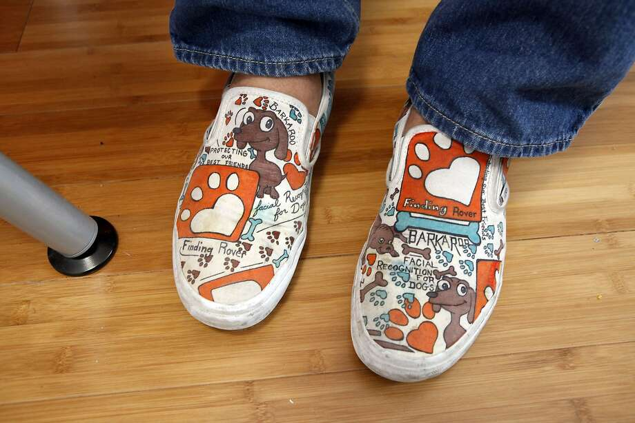 Finding Rover founder John Polimeno wears shoes designed by a friend that feature the startup's logo. Photo: Michael Short, The Chronicle