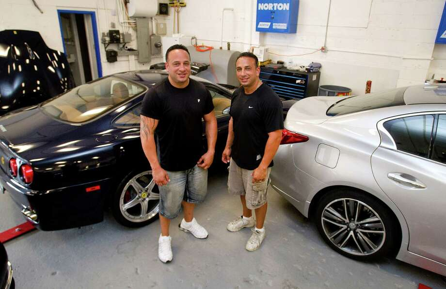 Al LoBalbo, left, and his twin brother Sal, right, pose for a photo in their newly opened auto body shop on West Main Street in Stamford, Conn., on Tuesday, July 15, 2014. The brothers also have a shop on Camp Ave. Photo: Lindsay Perry / Stamford Advocate