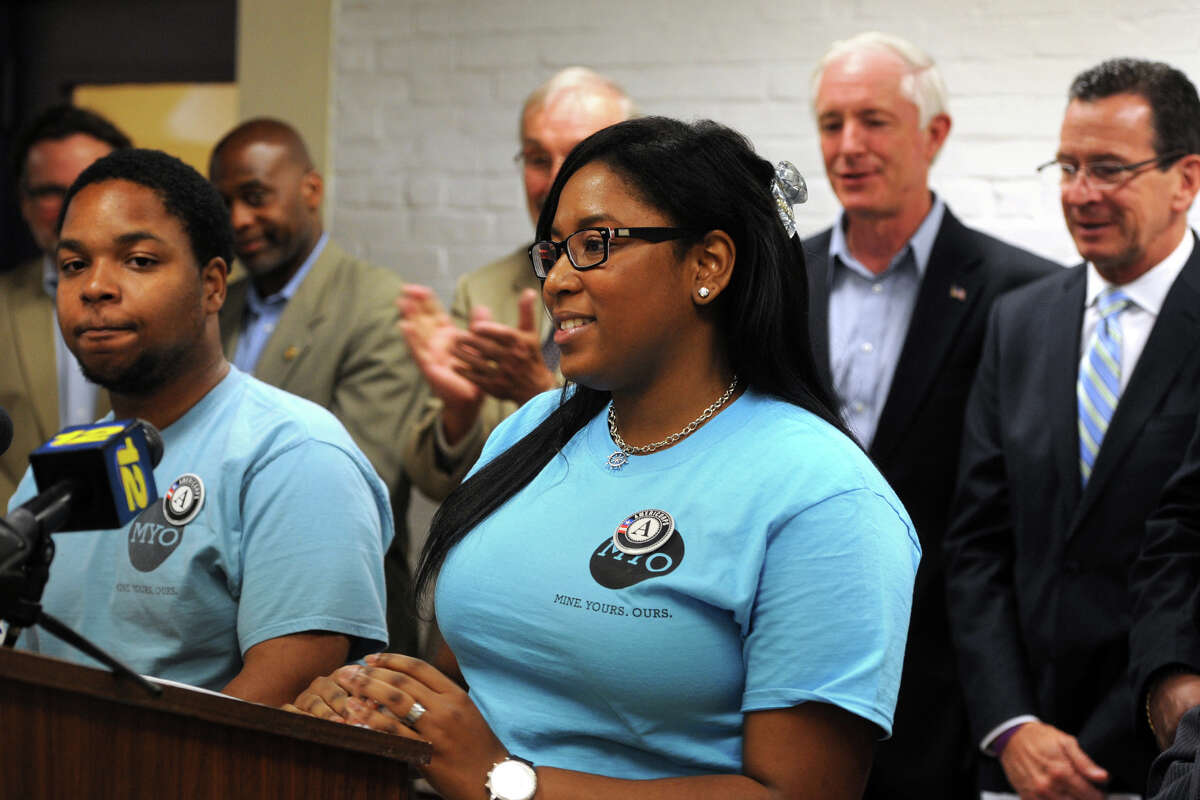 Ciera Clarke and Nigel Reid, from Regional Youth Adult Social Action Partnership (RYASAP), speak at a press in Bridgeport, Conn. July 15, 2014. Community leaders gathered to announce the allocation of Youth Violence Prevention grants to fight violent crime in Bridgeport.