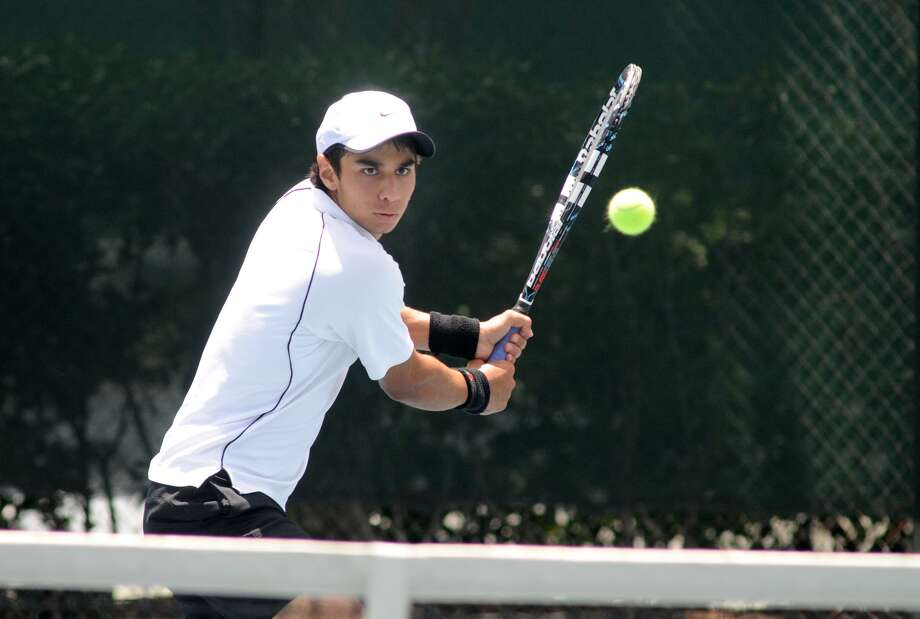 Xavier Gonzalez, 17, a senior at St. John's High School, works on his backhand during a match at the Houston Racquet Club. Freelance photo by Jerry Baker Photo: Jerry Baker, Freelance