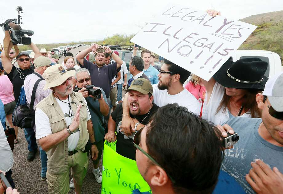 Pro-immigration activist Ricardo Reyes yells at anti-immigration activists during a rally in anticipation of the arrival of buses carrying undocumented immigrants to Oracle, Ariz. Photo: Sandy Huffaker, Getty Images