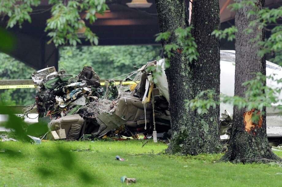 The scene of a plane crash at 120 Cottage Ave., Purchase, N.Y., Friday afternoon, June 13, 2014. A  Rockefeller family spokesman says the pilot of the small plane who died moments after taking off from a Westchester County airport Friday morning was Richard Rockfeller, great grandson of Standard Oil co-founder John D. Rockefeller. Photo: Bob Luckey / Greenwich Time
