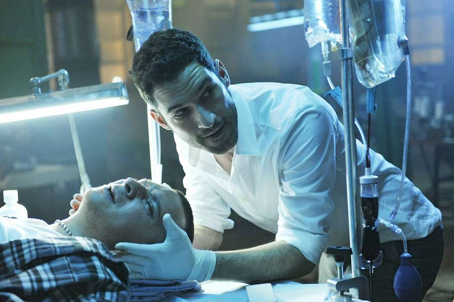 Tom Ellis plays Dr. William Rush, an amoral, drug-loving, womanizing sleazebag who gets paid cash and lots of it, up front and under the table, to fix celebrity problems. Photo: Alan Zenuk, USA Network