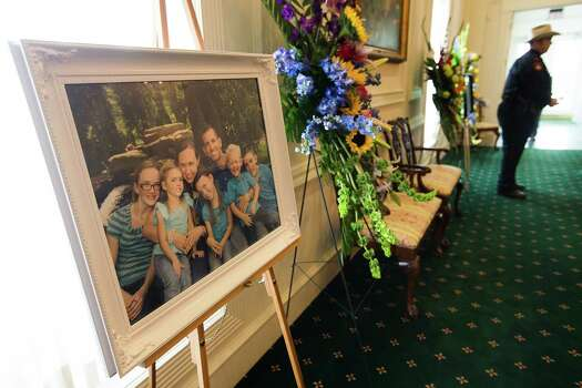 A family portrait of the Stephen and Katie Stay family is on display before visitation at Klein Funeral Home Tuesday, July 15, 2014, in Houston. Photo: Brett Coomer, Houston Chronicle / © 2014 Houston Chronicle