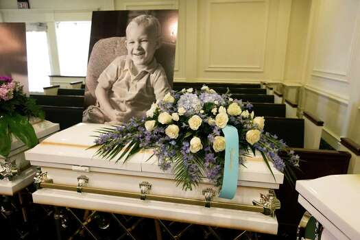 A photo of Zachary Stay is laid above his casket before visitation at Klein Funeral Home Tuesday, July 15, 2014, in Spring. He is one of six slain in a mass shooting last week. Photo: Brett Coomer, Houston Chronicle / © 2014 Houston Chronicle