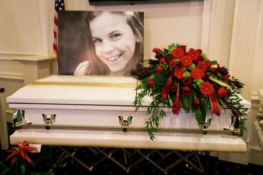 A photo of Emily Stay is laid above her casket before visitation at Klein Funeral Home Tuesday, July 15, 2014, in Spring. She is one of six slain in a mass shooting last week. Photo: Brett Coomer, Houston Chronicle / © 2014 Houston Chronicle