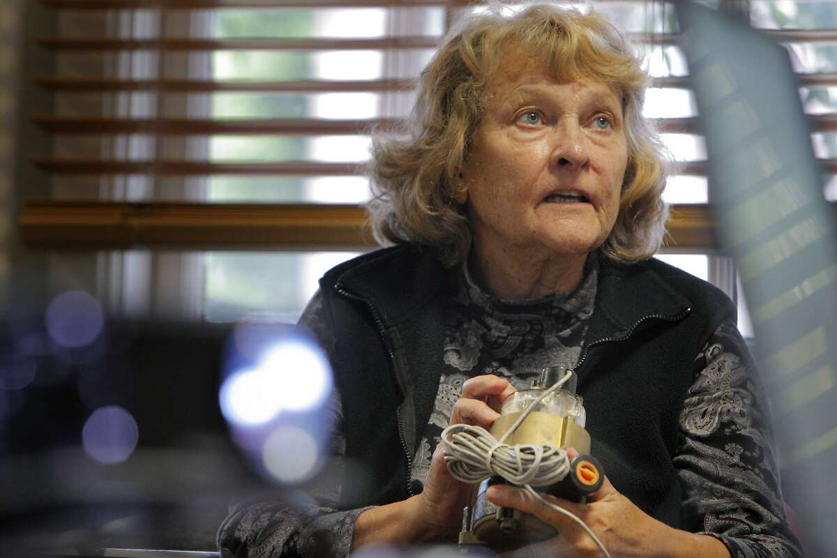 Sue Dirksen of Santa Cruz, listens to the presentation while examining a City of Santa Cruz water meter during Water School at the Louden Nelson Community Center in Santa Cruz, Calif., on Monday, July 14, 2014. The city of Santa Cruz has set up water school, a class where those who have exceeded their monthly water allotments can attend to learn about the drought and have penalties on their water bill removed. It is a free, one-time class in which you will learn how to manage water at your property, read a water meter, find and fix leaks, and more.
