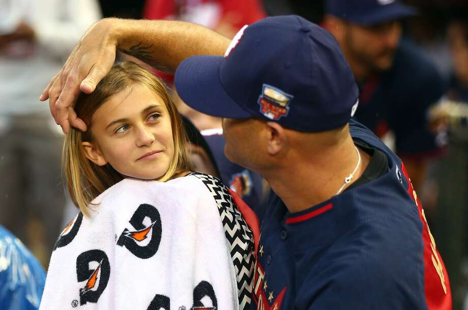 National League All-Star Tim Hudson of the San Francisco Giants with his daughter during the Gillette Home Run Derby. Photo: Elsa, Getty Images