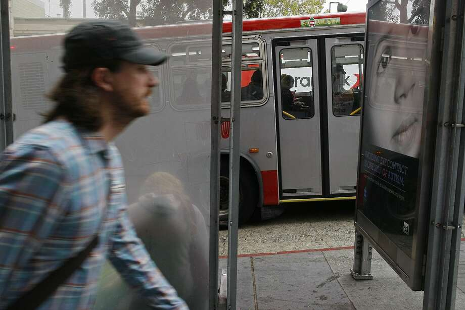 A man passes a Muni stop at Van Ness and Pacific avenues along a proposed bus rapid transit line due to begin service in 2018. Photo: James Tensuan, The Chronicle